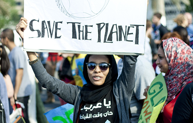 A woman marches at a climate change demonstration in Doha, December 2012. Credit: The Verb/Laura Owsianka, Flickr.