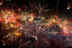 Fireworks light the sky over Tahrir Square in Cairo, Egypt, on July 3, 2013. Photo by Amr Nabil/AP.
