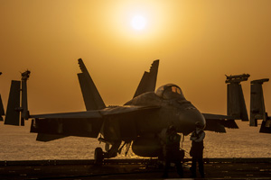 A U.S. Navy F/A-18E Super Hornet aircraft sits on the flight deck of an aircraft carrier in support of Operation Inherent Resolve against the militant group the Islamic State.