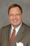 Mr. Larry E. Christensen